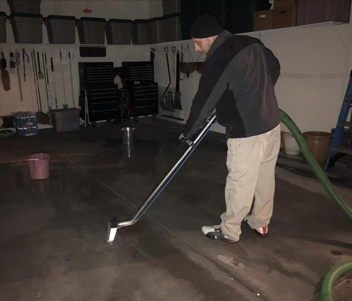 Technician using a steam cleaner in the garage