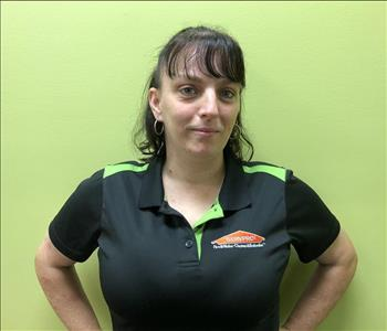 Female employee in a black shirt