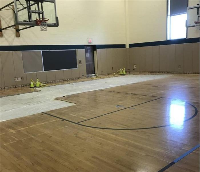 Partial hardwood flooring removed in a elementary school gym