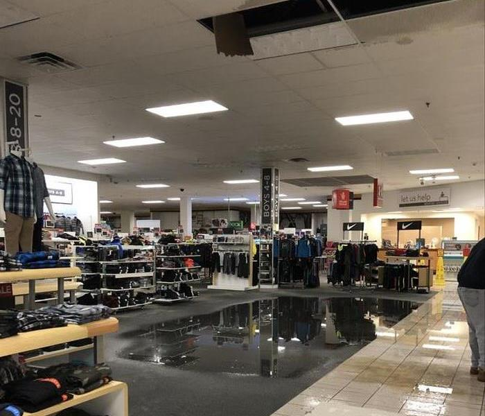 Large water puddle on carpet in department store